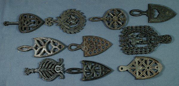 9: Lot of 10 handled cast iron trivets, longest 11""