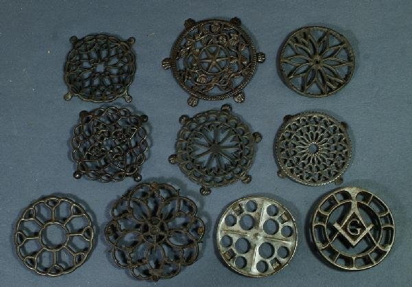 "10: Lot of 10 round cast iron trivets, longest 6 1/2"" d"