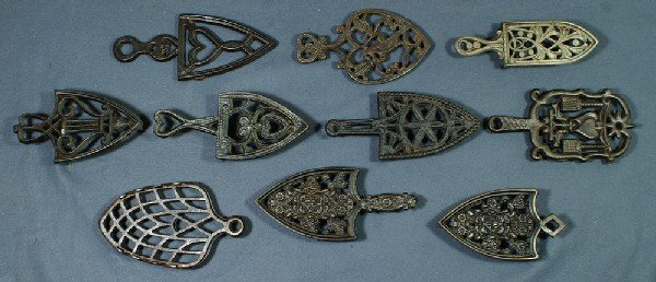 14: Lot of 10 handled cast iron trivets, longest 9""