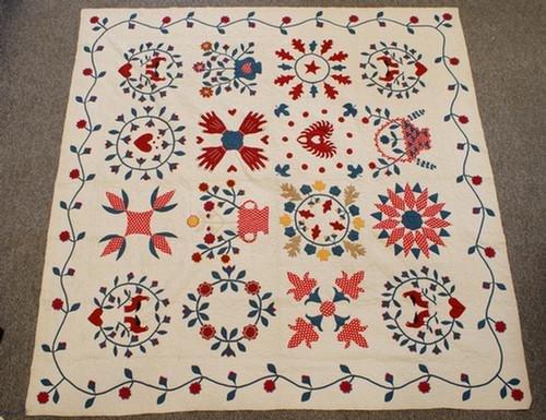 1017: 16 block sampler quilt, vine border, floral baske