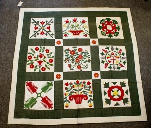 1019: 9 block sampler quilt, solid border, floral baske