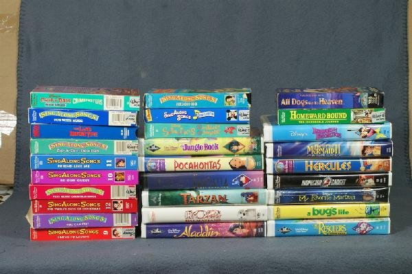 255: 28 VHS Disney movies, some with sing-along songs,