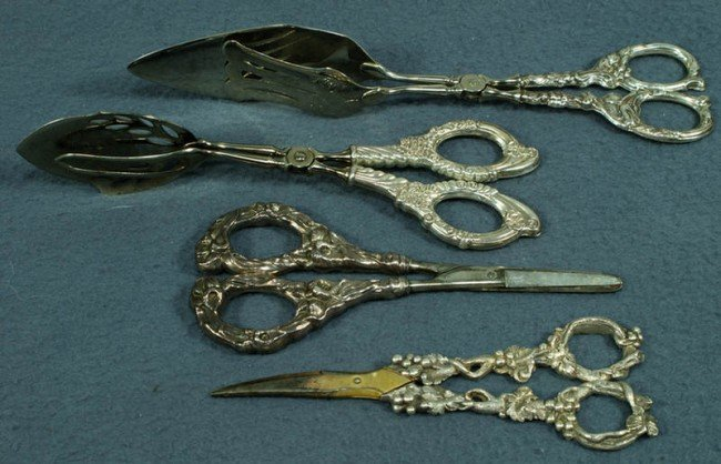 17: French cast silver handled grape shears, sterling h