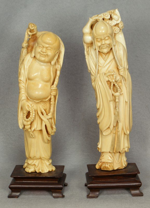 "244: 2 carved ivory figures, 11"" the tallest"