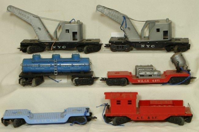 14: (6) Marx cars including tank car, 2 cranes, floodli