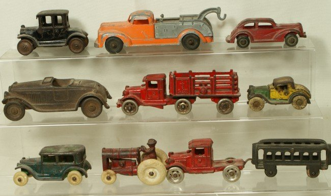 128: (10) cast iron vehicles, some hubbly and some arca