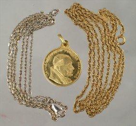 18: (2) 14K W&YG chains, 4.8 dwt, with an 18K YG papal
