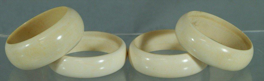 """10A: 4 plain ivory bangles, 1 1/8"""" to 3/4"""" w, 2 3/8"""" id"""