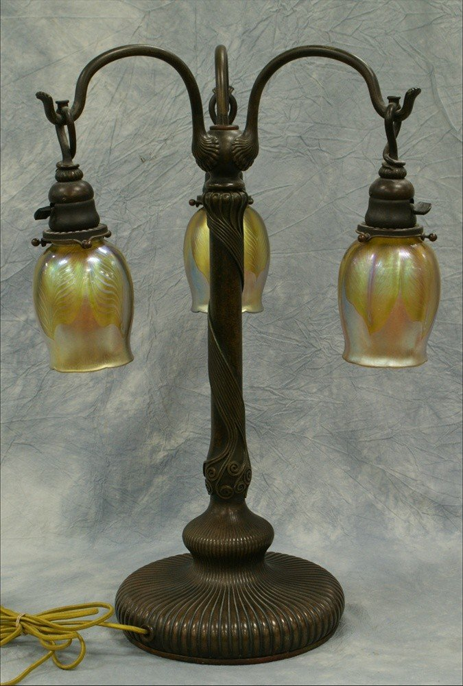 153: Tiffany Studios bronze and Favrile glass table lam