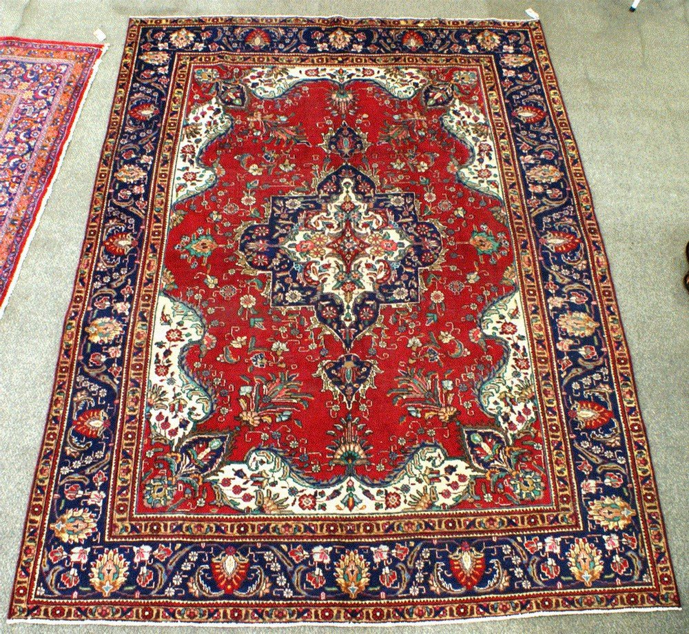 "5A: 7' 10"" x 11' red Persian carpet"