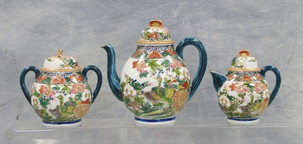 10021: Japanese porcelain teaset, c/o teapot, sugar, cr