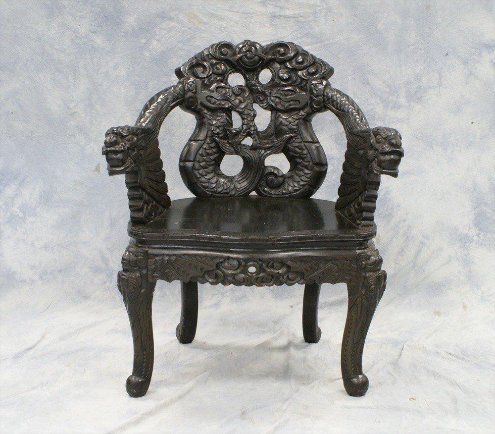 10104: (2) Japanese carved wood dragon armchairs, circa