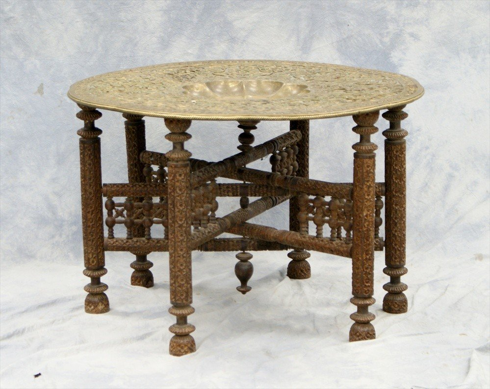 10110: Large Middle Eastern carved wood 6-legged table