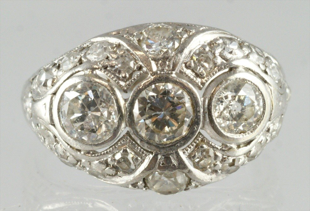 10089: Unmarked platinum 3 stone filigree diamond ring,