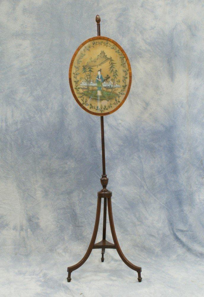 2230: Inlaid mahogany Regency firescreen, oval panel co