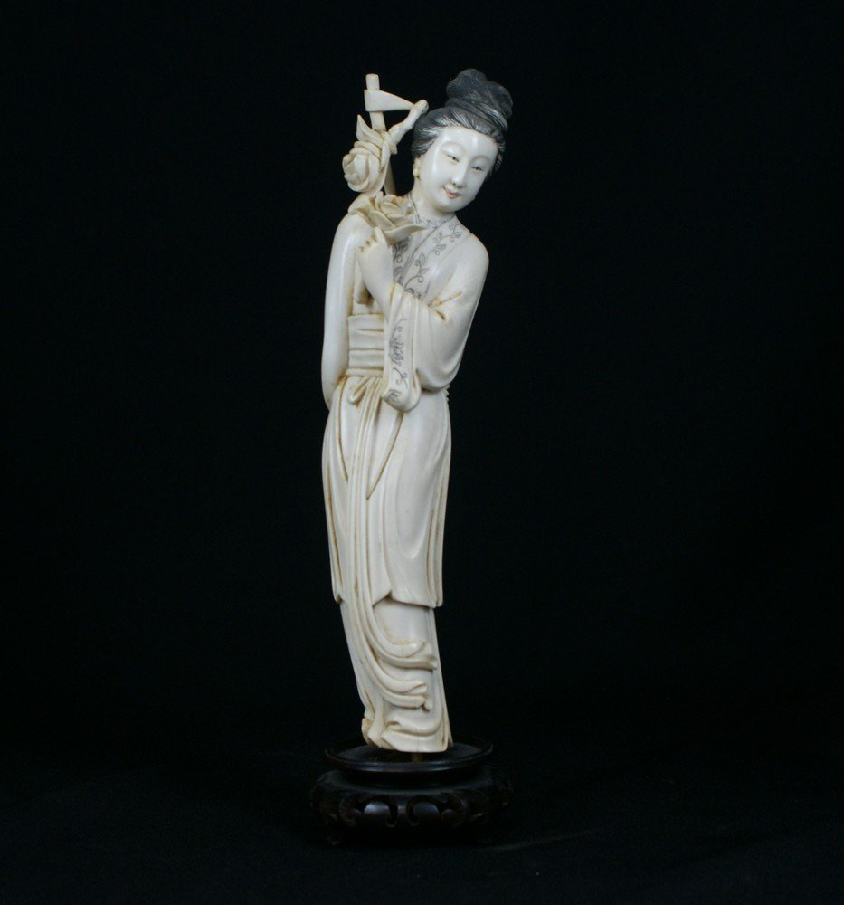 2135: Chinese Carved Ivory Maiden with flowers, 20th ce