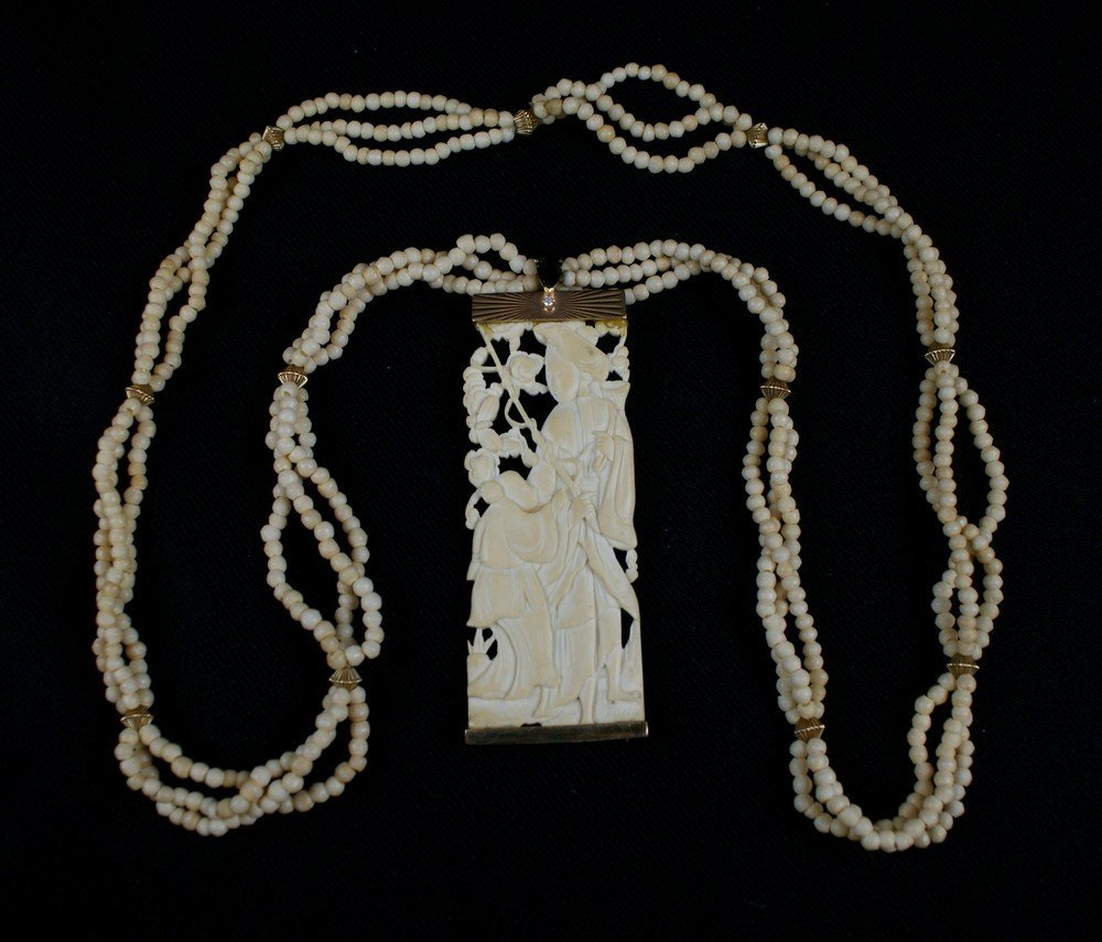 2139: Early Chinese Carved and Pierced Ivory Medallion