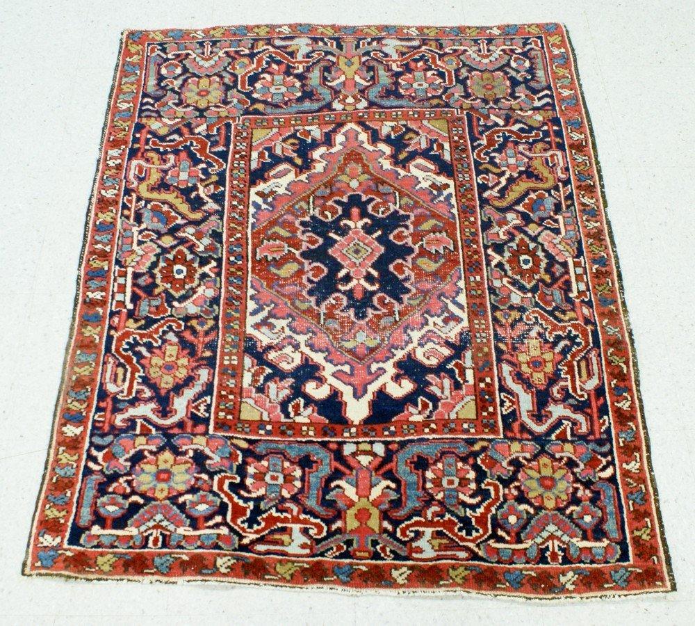 """2004: 3' 6 """" x 4' 3"""" Heriz throw rug (shows some wear)"""