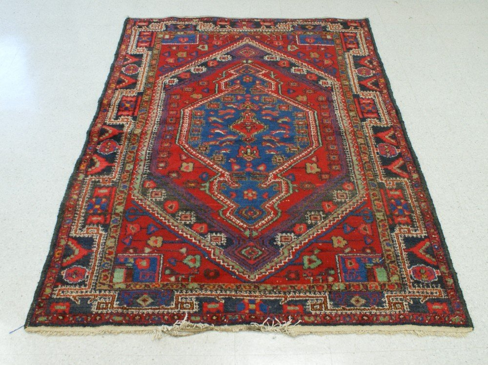 "2009: 4' 11"" x 7' Red Oriental throw rug"