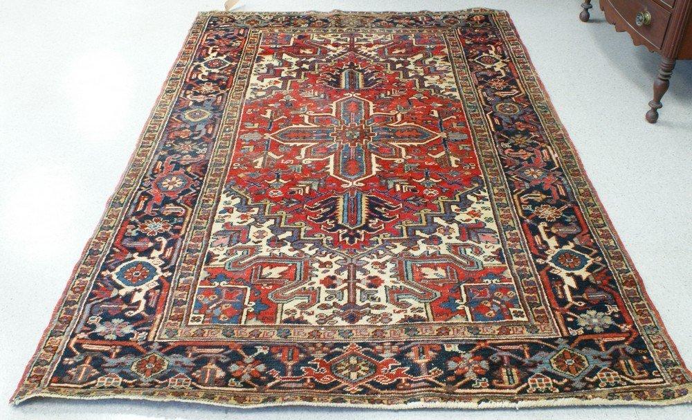 """2011: 5' 6"""" x 8' 4"""" Heriz rug (shows some wear)"""