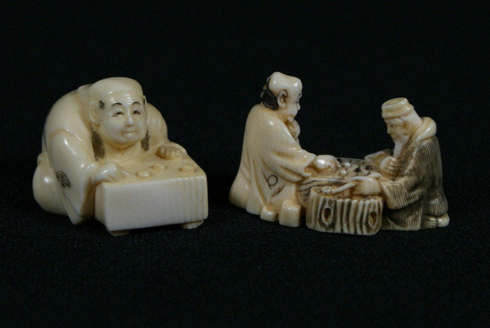 2137G: 2 carved ivory netsuke, men playing board games,
