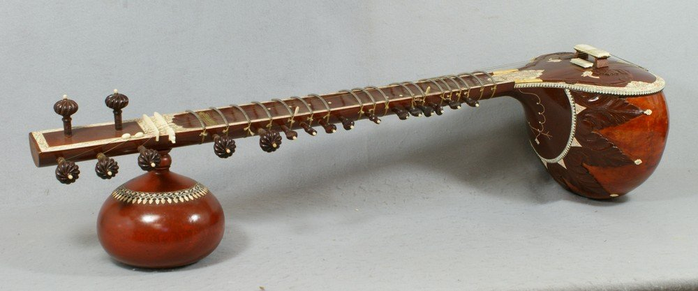 2058: Carved and inlaid sitar, labeled from the Lahore