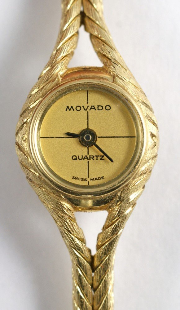 "2093D: 14K YG Movado ladies wrist watch, 1/2"" d, 6 3/4"""
