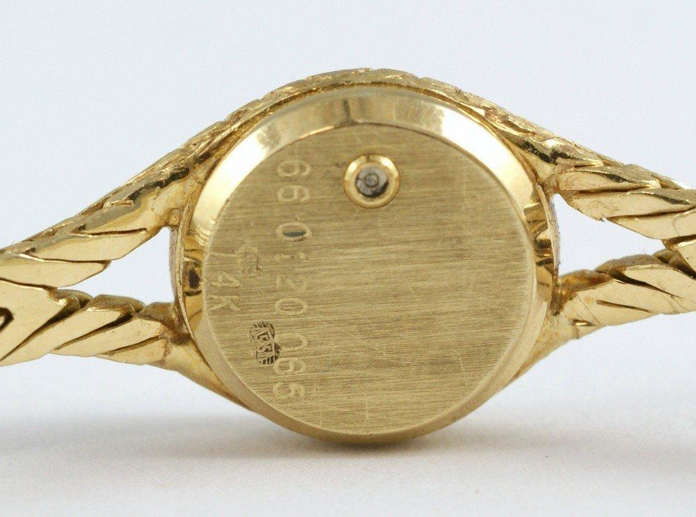 "2093D: 14K YG Movado ladies wrist watch, 1/2"" d, 6 3/4"" - 5"