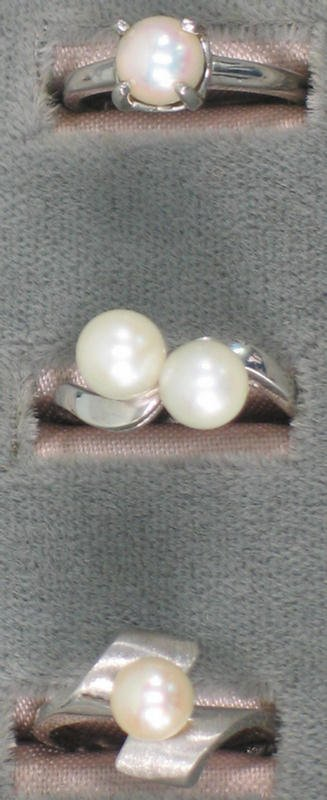 1: Three 14K wg pearl rings.  One ring is set with a si