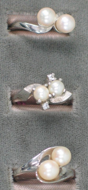 3: Three white gold pearl rings.  Two are 14K wg, each