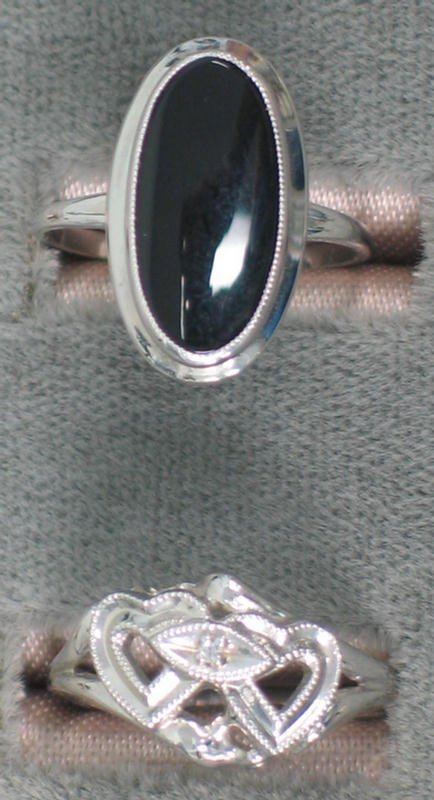 6: Two 10K wg rings. One set with an oval black onyx ta