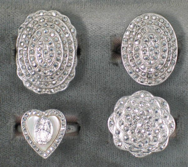 14: Four sterling and marcasite rings. Including one wi