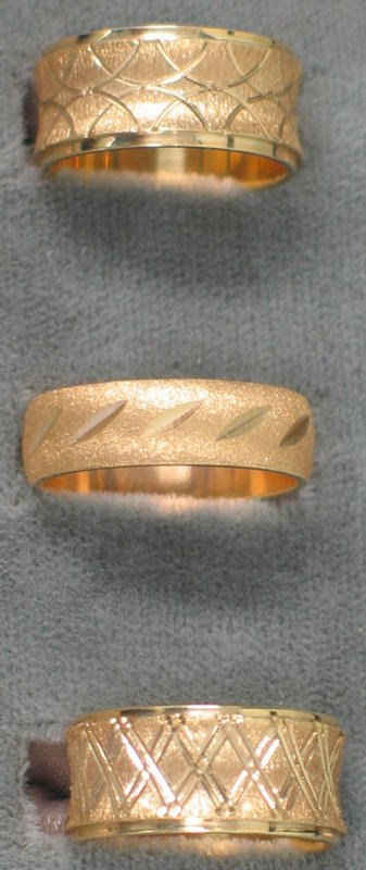 21: Three lady's wedding bands. All 14K yg with engrave