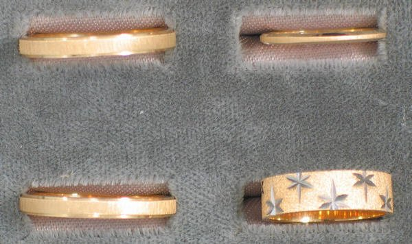 22: Four wedding bands. Two men's and two lady's 14K yg