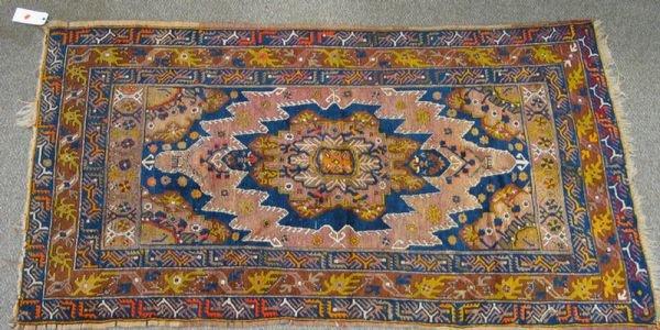 223: 4.1 x 7.3 Turkish rug, losses at ends