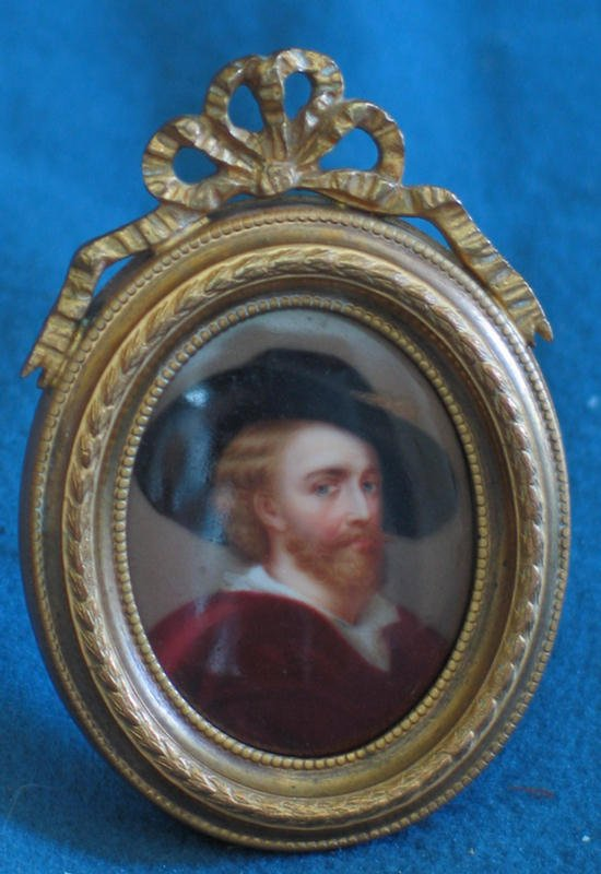 1001: Oval portrait on porcelain of bearded man in hat,