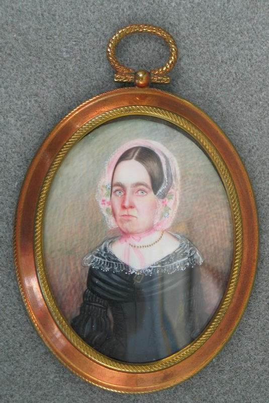 1008: Oval hand painted portrait on ivory of Woman in F