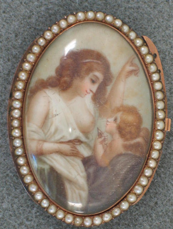 1010: Oval hand painted ivory of cherub with maiden, ro