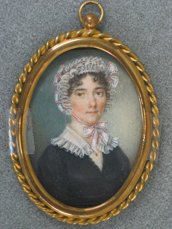 1011: Oval hand painted portrait on ivory, lady in lacy