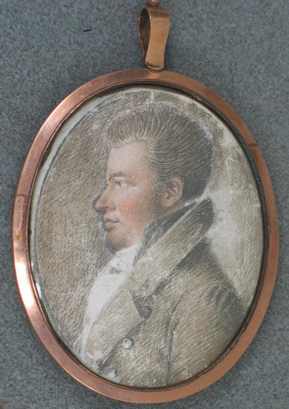 1021: Oval hand painted portrait on ivory of young offi