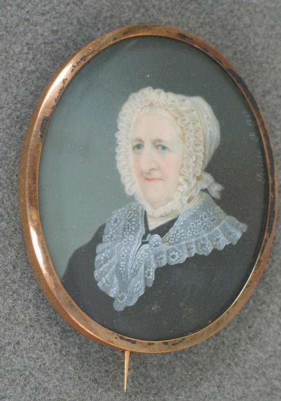 1023: Oval hand painted portrait on ivory of older woma
