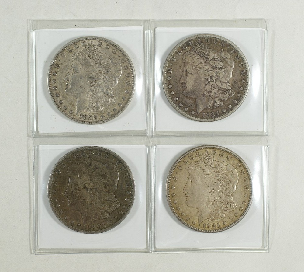 5018: 4 different Morgan dollars good to very fine 1882