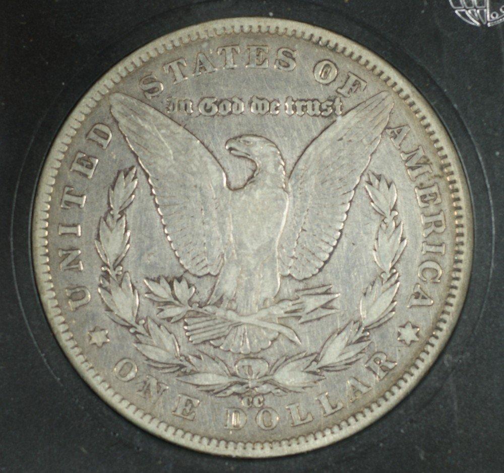 5071: 1892cc Morgan Dollar in a coin world slab graded  - 2