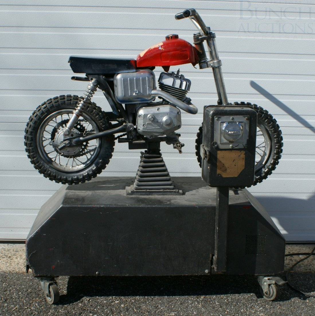 11: Italjet mini bike converted and mounted as a coin o