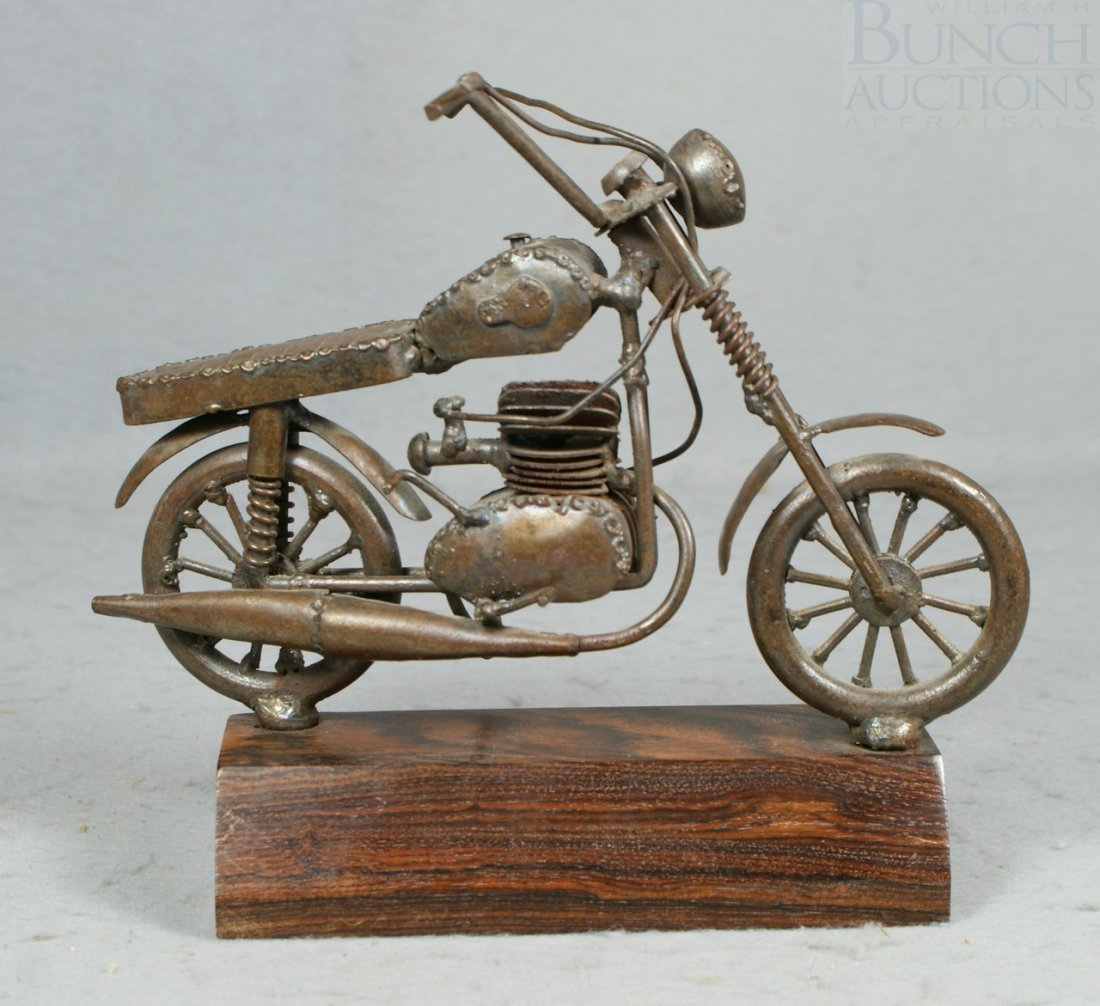 14A: Bronze patinated metal folk art motorcycle, mounte