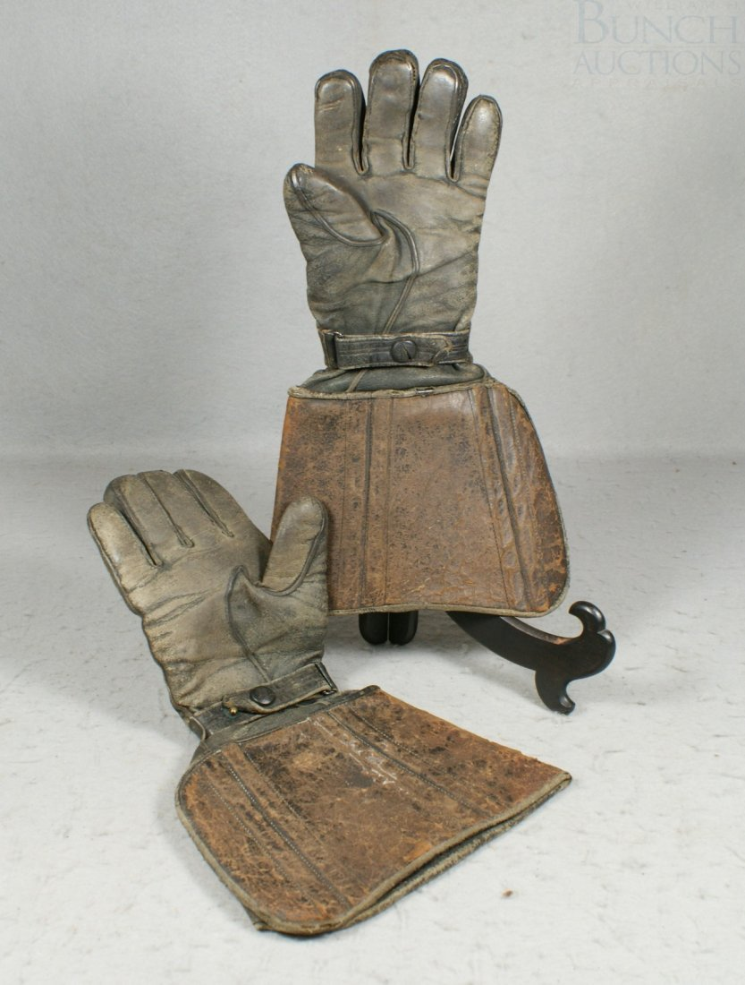 "27A: Worn black leather driving gloves,  14"" long"
