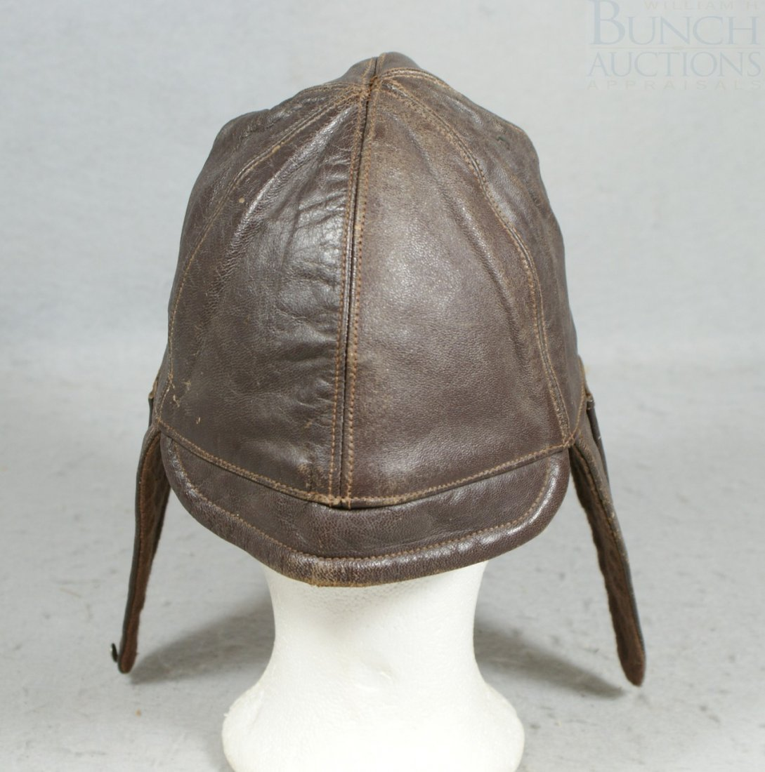 33A: French brown leather riding hat, with bill, St Eti