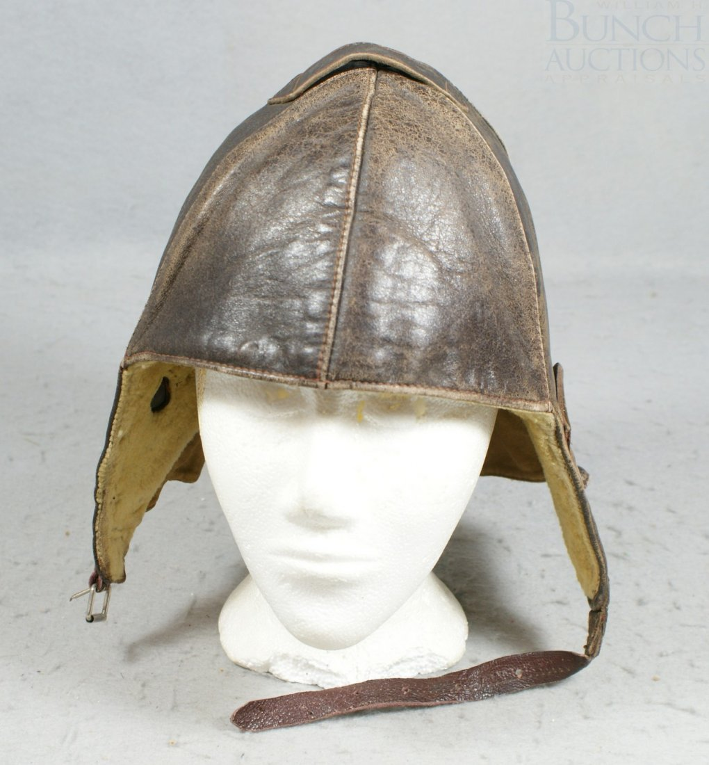 35A: Brown leather riding hat, ear flaps, neck flap, go