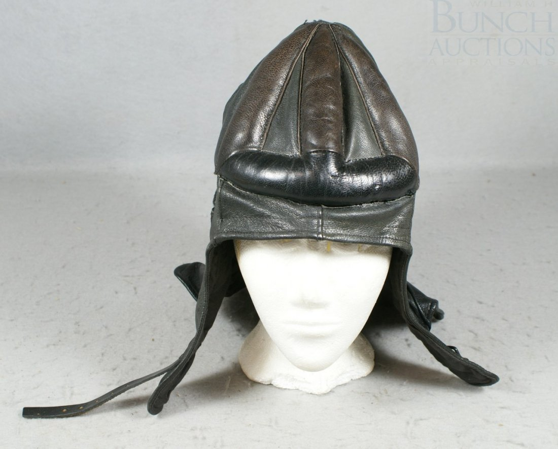 38A: Black leather riding cap, good condition