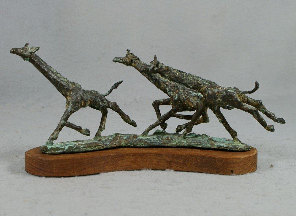 3152: Bronze sculpture of 3 giraffes running, signed W
